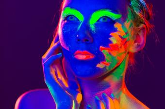 Woman painted with glow paint