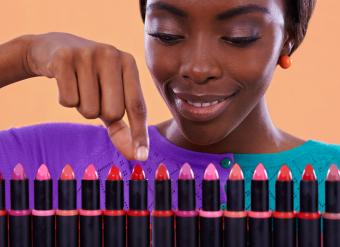 woman viewing colorful lipsticks