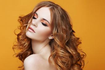 Woman wearing makeup in warm tones