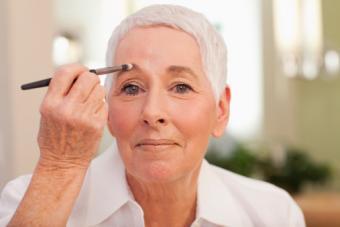 woman applying eyebrow makeup