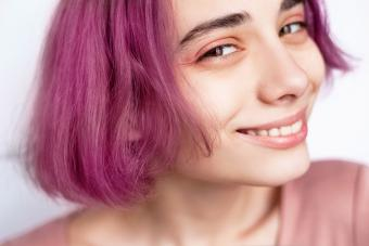Close-up of young woman with peachy-pink makeup
