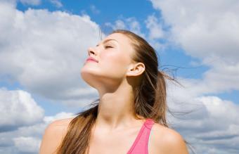 Sun shining on a woman's face