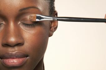 Woman with eye make up brush on eye