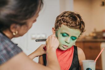 Boy wearing makeup during Halloween