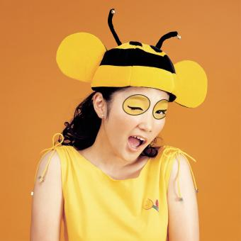 Woman with bumblebee makeup winking