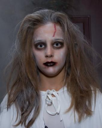 Girl wearing ghost makeup