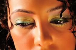 Woman wearing green liquid liner