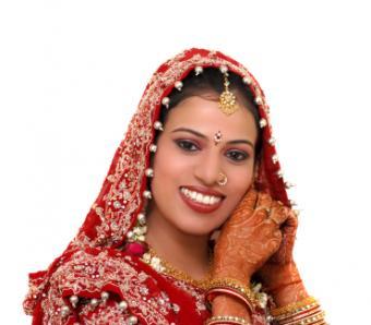 Mehendi designs decorate hands and feet.