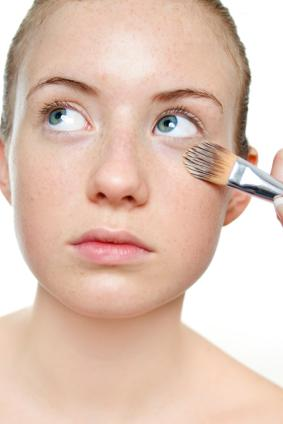 Apply concealer with a brush.