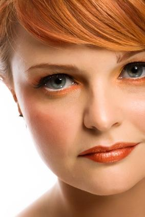 redhead with light green eyes and copper eyeshadow