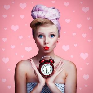 Beautiful woman holding clock