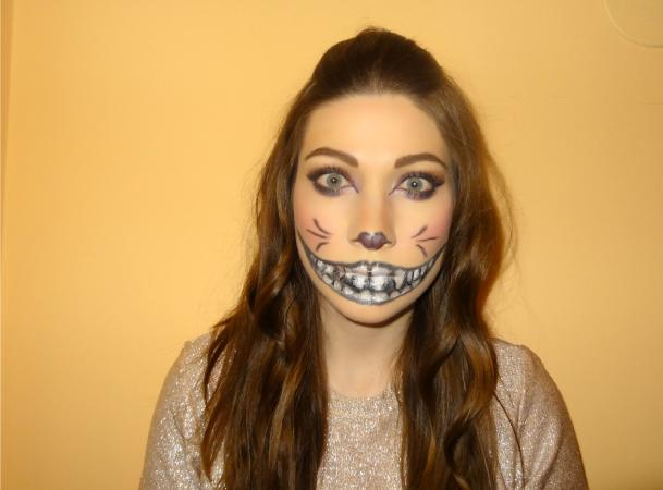 Woman modeling full Cheshire cat makeup