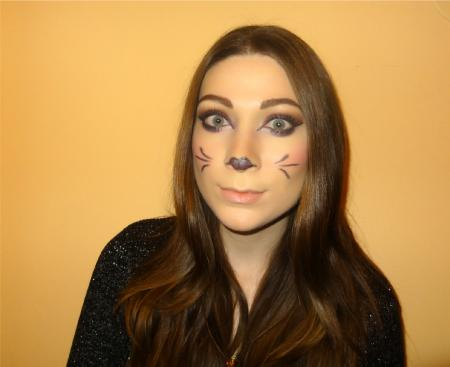 Woman modeling Cheshire cat cheeks and nose