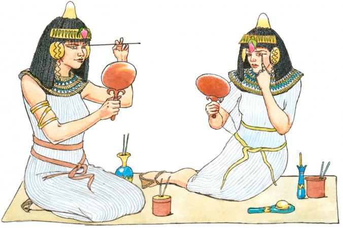 Egyptian women applying makeup