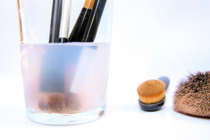 Makeup brushes in cleaning solution