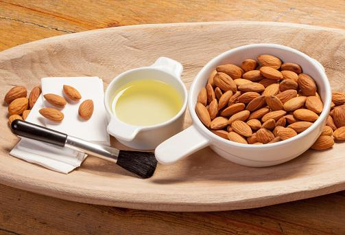 Almond oil almonds and make-up utensils