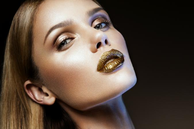 girl with gold glitter lipstick