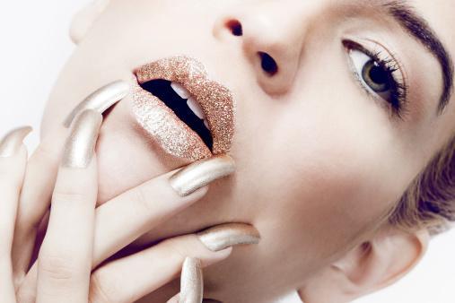 Glitter lips and metallic nails