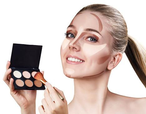 woman holding makeup palette