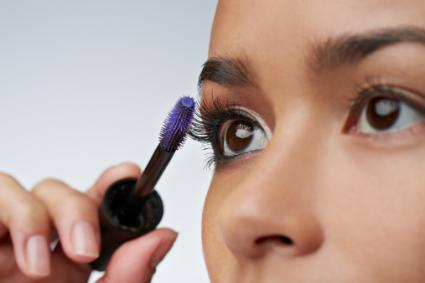 woman using eyelash brush