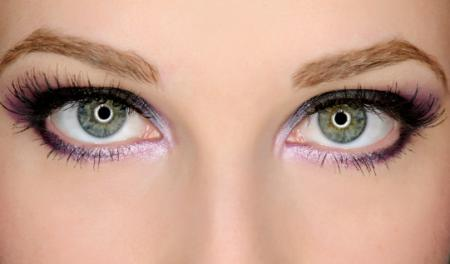 purple make up on green eyes