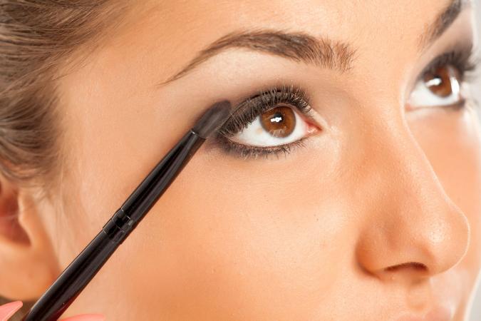 Applying makeup for smoky eyes