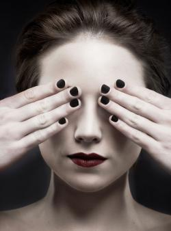 woman with short dark fingernail polish
