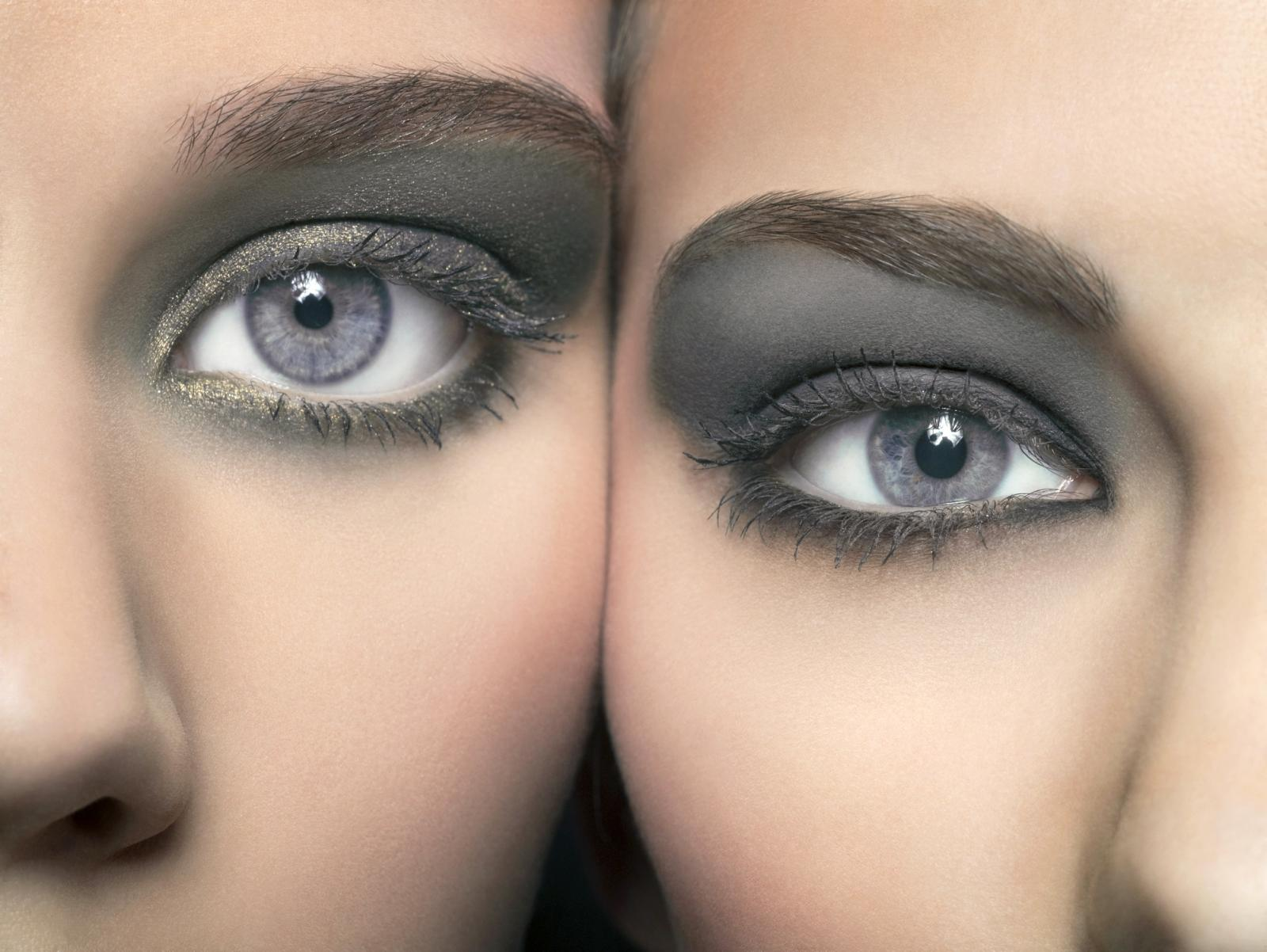 Close-up of young women's eyes with grey eye shadow