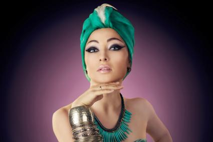 Beautiful woman in oriental style in turban