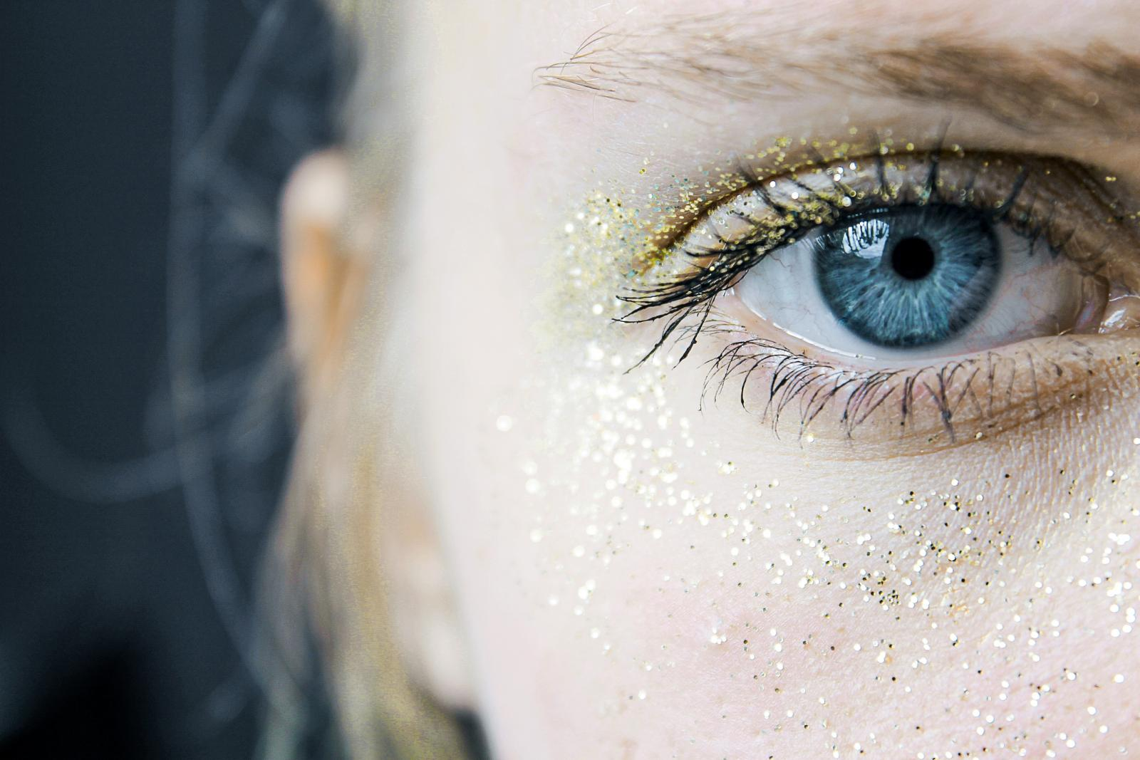 Young woman with sparkly makeup