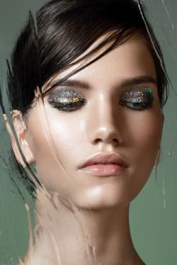 Beautiful woman with classic glitter makeup