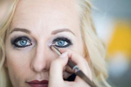 Applying makeup inner corner of eye