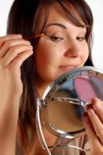 Brunette teen with makeup mirror