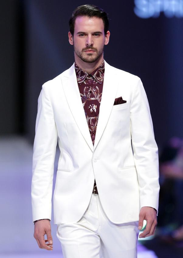 https://cf.ltkcdn.net/mens-fashion/images/slide/198908-602x850-designer06_whitecrop.jpg