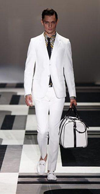 https://cf.ltkcdn.net/mens-fashion/images/slide/49133-330x640-men-suit3.jpg