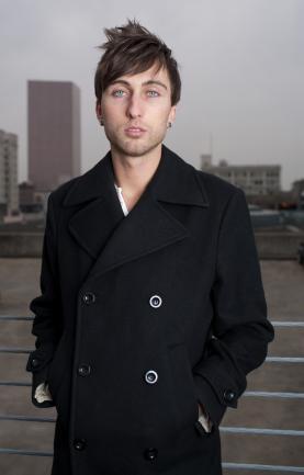 man in black pea coat