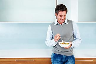 Man dressed in preppy sweater vest and shirt