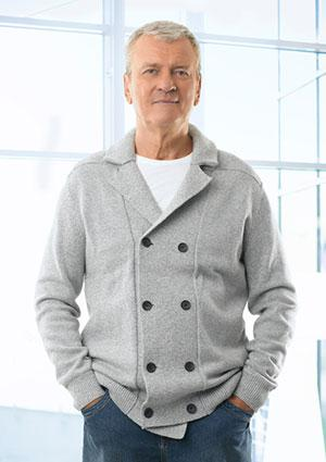 Senior man wearing jeans and a cardigan sweater