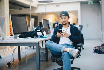 sitting on chair in office