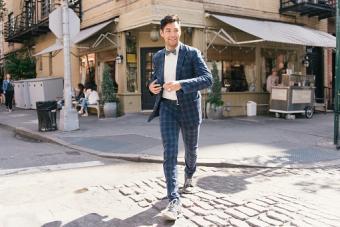 Stylish businessman crossing road