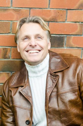 man wearing brown leather jacket