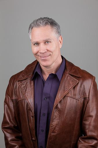 man wearing leather jacket