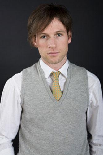 man in grey sweater vest
