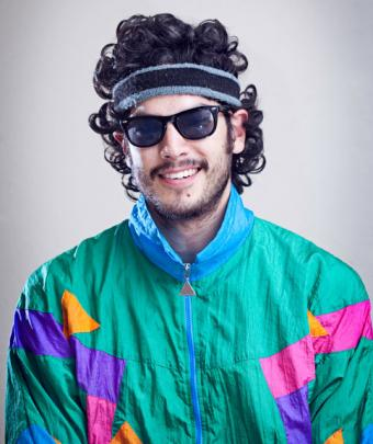 Man wearing sunglasses in track suit