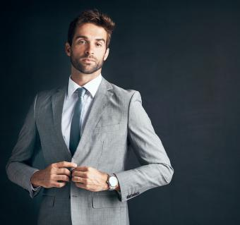 Confident and stylishly dressed young businessman