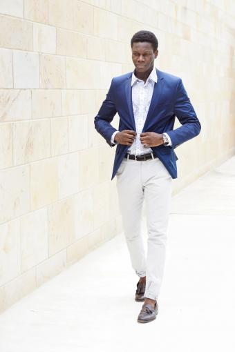 Confident young man in casual tailoring