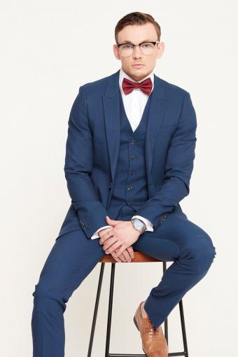 Classic blue blazer and red bow tie