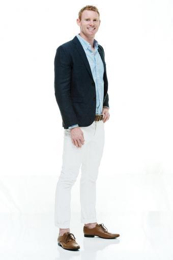 Dark blazer with light colored pants