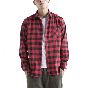 Man in a button down plaid flannel shirt