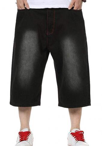 Man wearing short baggy jeans